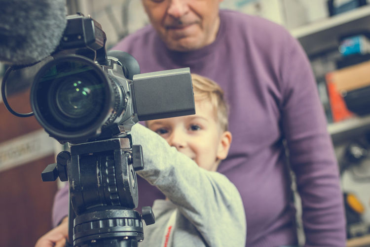 Boy With Grandfather Using Television Camera