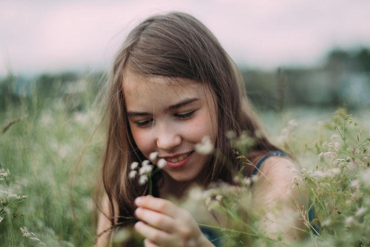 Portrait of a girl in a field