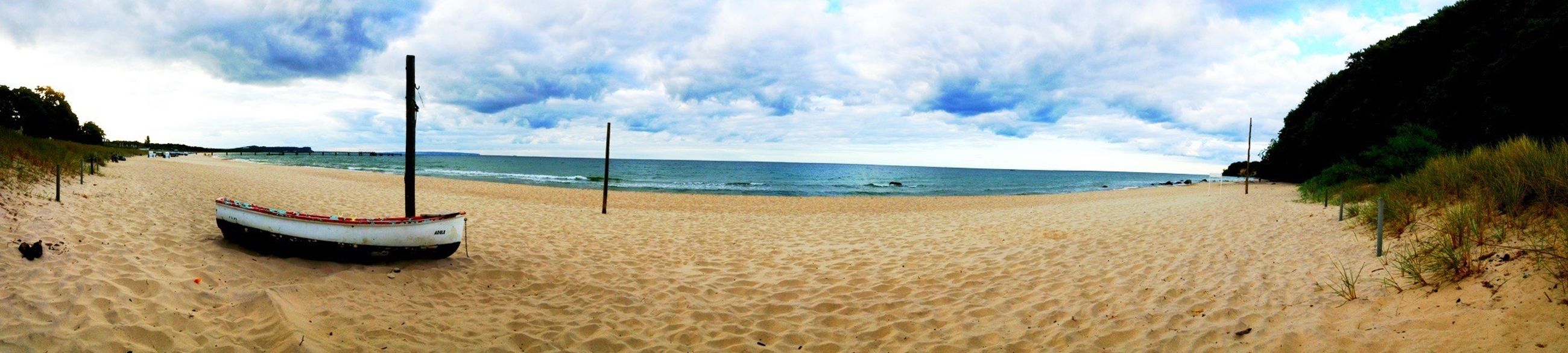 beach, sea, sand, water, sky, horizon over water, shore, tranquility, tranquil scene, scenics, beauty in nature, cloud - sky, cloud, nature, panoramic, nautical vessel, incidental people, vacations, idyllic, boat