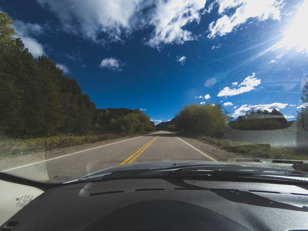 Car Car Interior Car Point Of View Cloud - Sky Dashboard Day Land Vehicle Landscape Mode Of Transport Nature No People Outdoors Road Road Trip Scenics Sky Speedometer The Way Forward Transportation Tree Vehicle Interior Windscreen Windshield