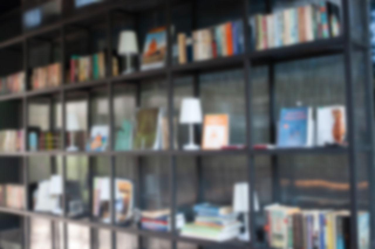 FULL FRAME SHOT OF BOOKS IN SHELF AT LIBRARY