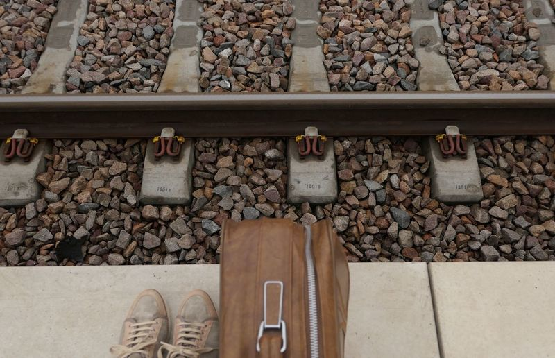 Low Section Of Man By Luggage At Railroad Platform