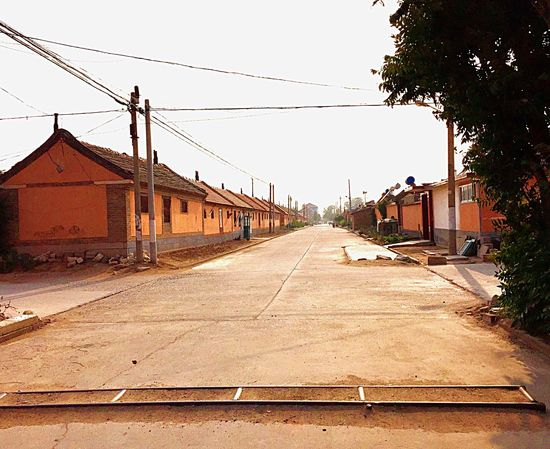 A village in northern China Street Road Houses Farmhouses Power Lines Electrical Poles Rural Urban Countryside Village Homes Travel Shandong China Culture Colour Of Life Street Blockers Color Palette