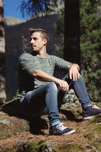 Nature EyeEm Selects One Person Casual Clothing Sitting Young Men Lifestyles The Modern Professional Tree Nature Looking Away Contemplation Outdoors Sunlight Real People The Modern Professional