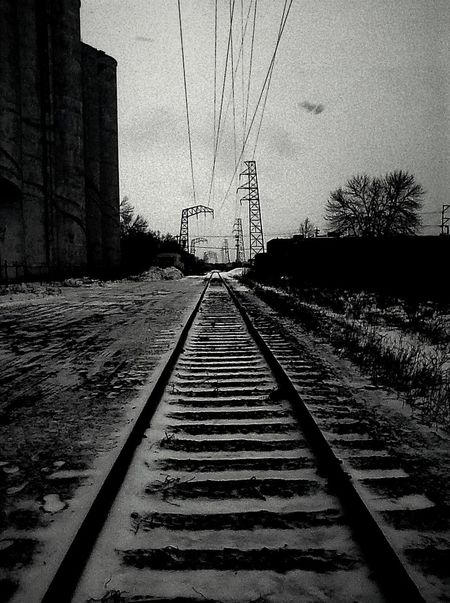 Showcase: February Minneapolis. No People No Trespassing Tracks Tracks In Snow Tracks In The Snow Train Desolate Deterioration Urban Landscape Urban Minneapolis Building Building Exterior Black Blackandwhite Cityscapes Beautiful Metal Landscape Buildings & Sky Old Objects Obsolete Eyeem Popular Photos Street Photography