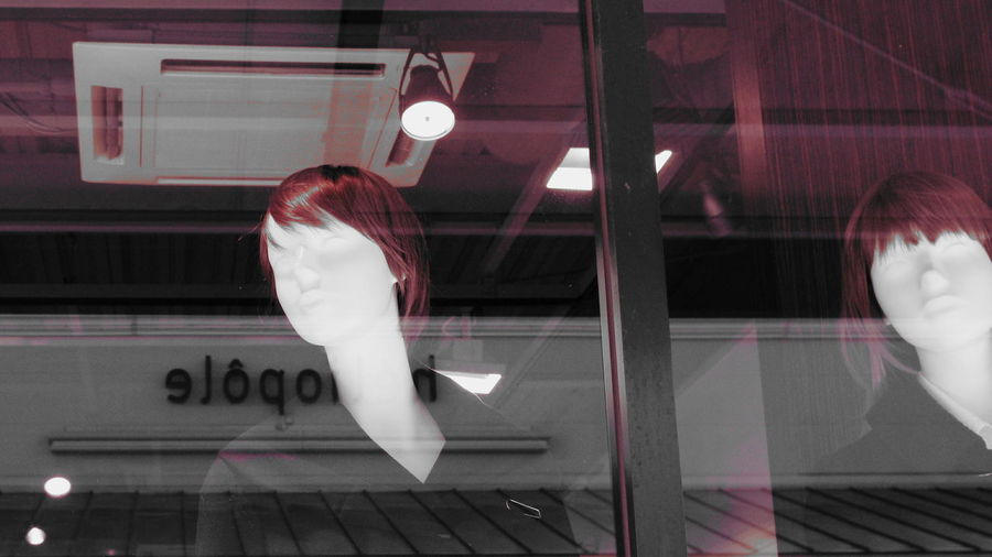 Mannequin At Window Display In Store