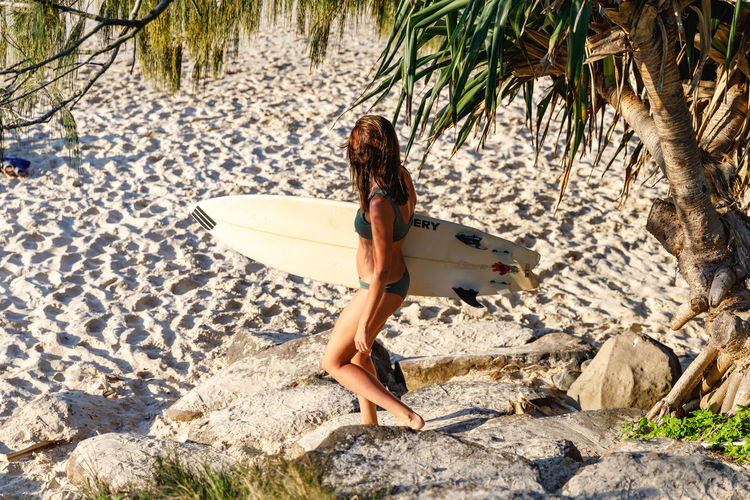 Byron Bay, Australia One Person Real People Full Length Leisure Activity Nature Lifestyles Women Day Sunlight Tree Land Young Adult Adult Sitting Young Women Vacations Trip Clothing Beautiful Woman Outdoors Hairstyle Surf Byron Bay Australia Surfing