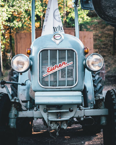 Mode Of Transportation Land Vehicle Transportation Day No People Headlight Text Communication Motor Vehicle Focus On Foreground Car Retro Styled Outdoors Close-up Western Script Metal Lighting Equipment Sign Stationary