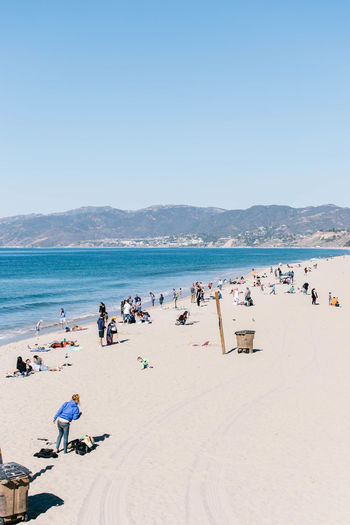 Los Ángeles Santa Monica Adult Adults Only Beach Beauty In Nature Blue Clear Sky Day Horizon Over Water Large Group Of People Leisure Activity Lifestyles Men Nature Outdoors People Real People Sand Scenics Sea Shore Sky Summer Vacations Water Women