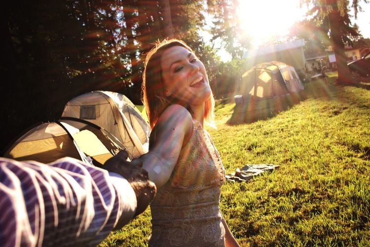 One of those fun pull person images Sun Girl Canon Sunbeam Outdoors Sunlight Lens Flare Tree One Person Real People Young Adult Leisure Activity Young Women Nature Day Happiness Grass Smiling