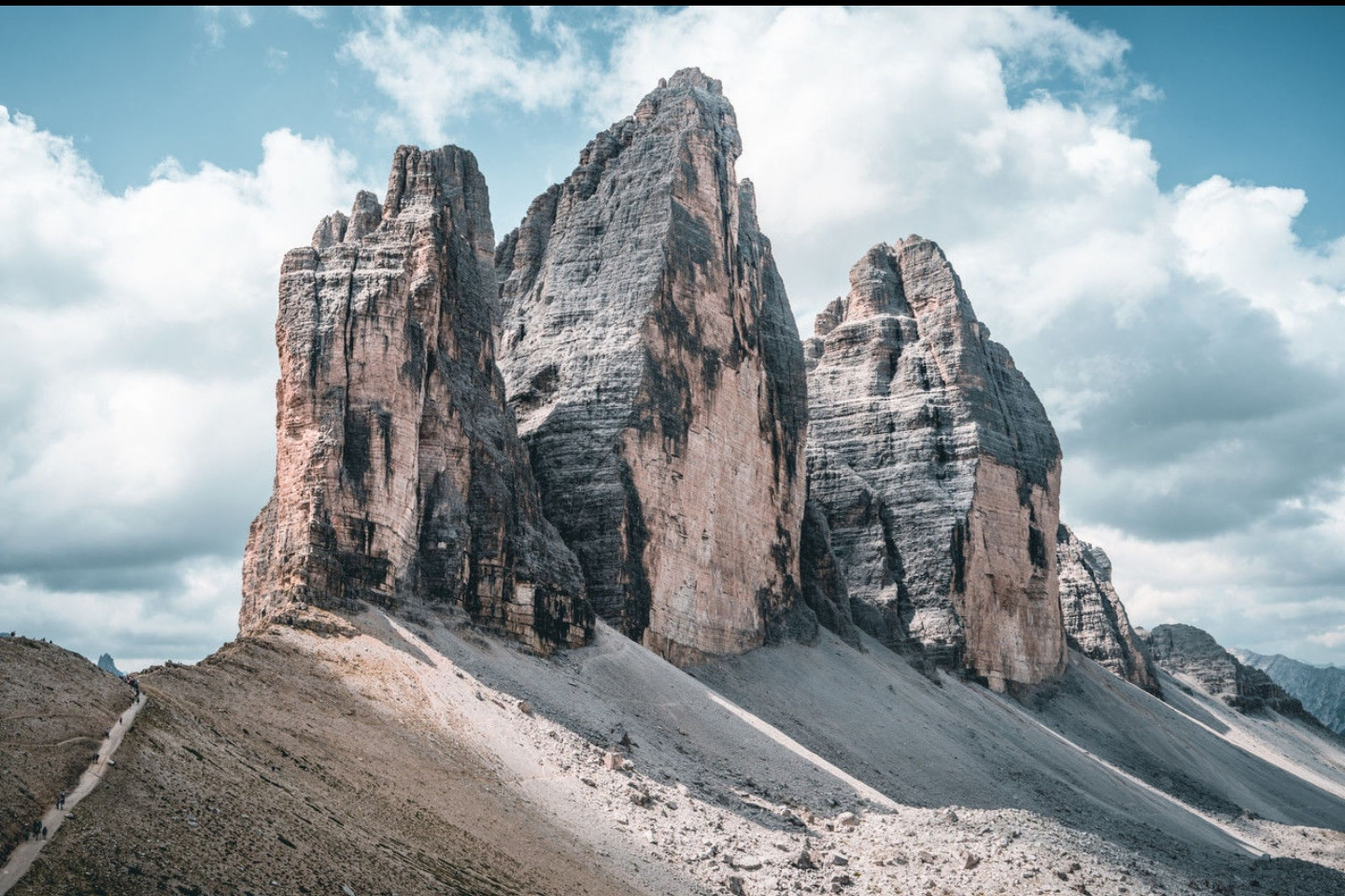 cloud - sky, sky, rock, rock formation, scenics - nature, mountain, beauty in nature, rock - object, nature, day, tranquil scene, solid, landscape, environment, mountain range, no people, tranquility, non-urban scene, travel destinations, land, outdoors, formation, mountain peak, eroded, arid climate