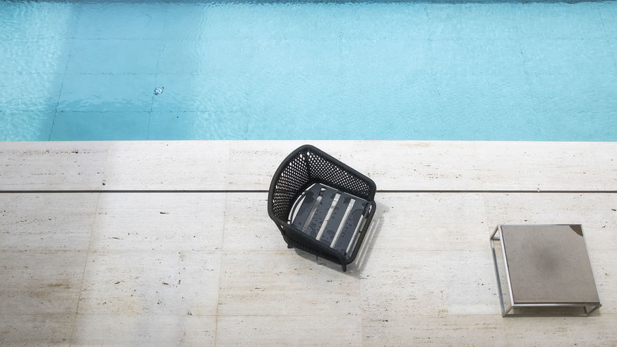 High angle view of chair on swimming pool