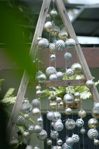Close-up of decorations hanging on metallic structure
