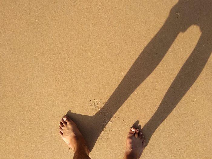 Low Section Beach Women Shadow Sand Standing Human Leg Sunlight barefoot High Angle View