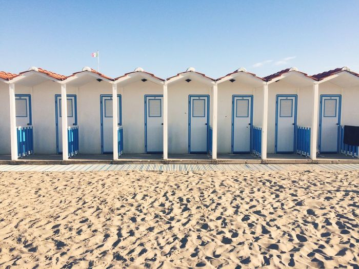 Huts At Beach Against Sky On Sunny Day
