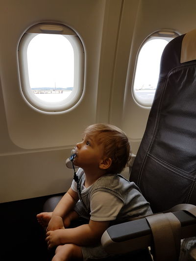 Toddler sitting in airplane