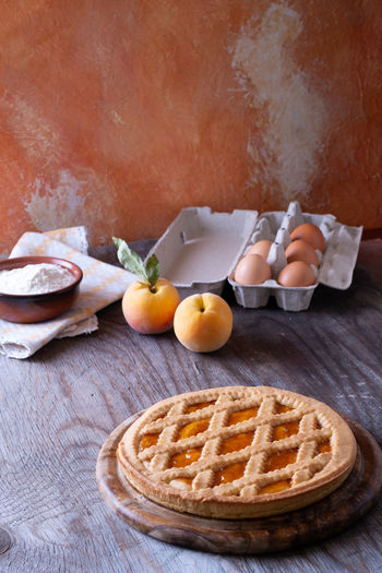 Tart with peach jam Tart Apricot Egg Food Food And Drink Freshness Fruit Healthy Eating Household Equipment Indoors  Indulgence Jam Kitchen Utensil No People Peaches Pie Plate Ready-to-eat SLICE Still Life Sweet Food Table Temptation Wellbeing Wood - Material