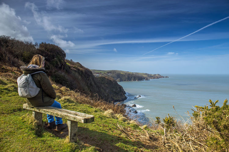 Beautiful Combe Martin Devon Coast England, UK Hangman Hills Lady Landscape_Collection Nature North Devon Ocean View Wellness Woman Backpacker Bench With A View Coast Path Exmoor Female Hiker Hiking Trail Lone Walker Outdoors Scenics Seascape Tranquil Scene Walker