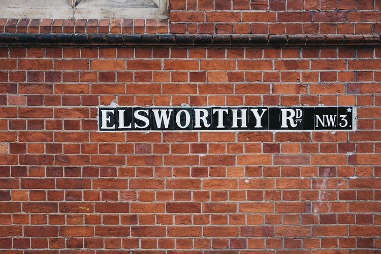 Street name sign on Elsworty Road in London, UK. London Uk Primrose Hill Elsworty Road Brick Wall Street Name Sign Brick Wall Architecture Close-up Day Sign No People Outdoors Travel Tourism Street Sign Street Pattern Wall - Building Feature