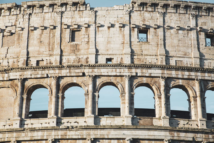 Detail of the ancient colosseum of rome located in the city center, travel reports