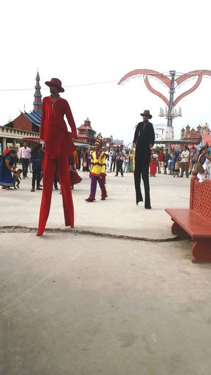 Performer  Performers Streetperformer Peoplesmall Bhopal, Madhya Pradesh, India Public Public Art Public Places Fun LongLegs Longwoodenlegs Red Dressedinred Evening Sky Evening Afternoon Outdoor Photography out of the box Outfit Entertainers Joker Nature Clothing Crowd Outdoors