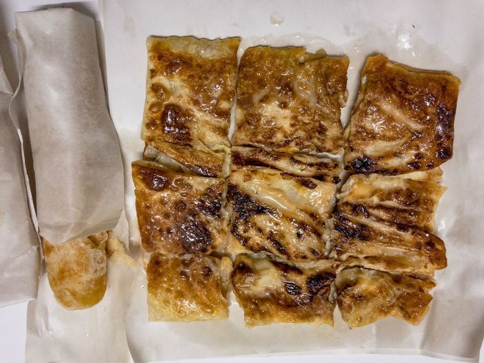 Dessert style of fried Roti with banana cooking on the street Food Food And Drink Still Life Freshness Ready-to-eat Indoors  Serving Size Close-up No People มะตะบะ Roti Mataba The Beater Chef Sweet
