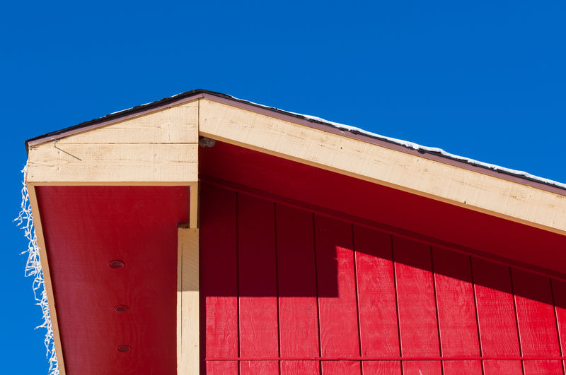 Red building against clear blue sky