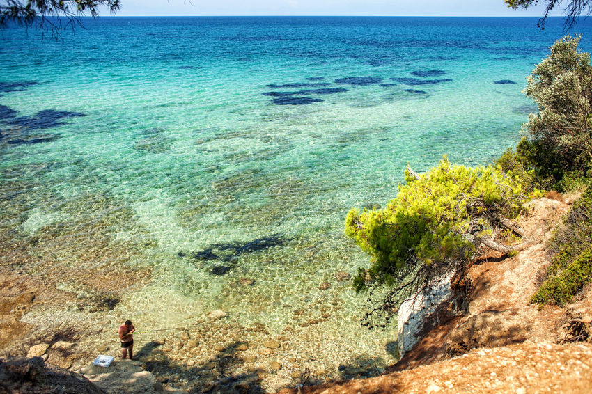 Wild beach in Greece Beach Beauty In Nature Blue Coastline Horizon Over Water Nature Non-urban Scene Rock Formation Scenics Sea Summer Tourism Tranquil Scene Tranquility Vacations Water