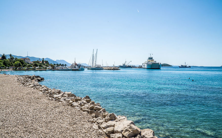 harbour of Orebic Astrology Sign Beach Blue Clear Sky Croatia Day Ferry Harbor Harbor Mode Of Transport Nautical Vessel No People Orebic Outdoors Sailing Ship Sea Ships Sky Sunny Tall Ship Transportation Tree Water