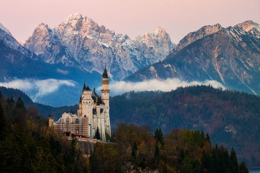 Neuschwanstein Castle Neuschwanstein Architecture Beauty In Nature Building Exterior Built Structure Day Germany Mountain Mountain Range Nature No People Outdoors Place Of Worship Religion Scenics Sky Snow Spirituality Tranquility Travel Destinations Tree