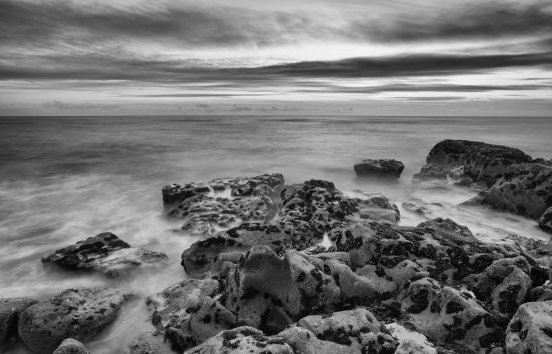 Rugged coastline Rough Sea Rugged Storm Weather Beach Beauty In Nature Black And White Cloud - Sky Cold Day Horizon Over Water Long Exposure Moody Motion Nature No People Outdoors Rock - Object Scenics Sea Sky Stormy Water Wave Wild