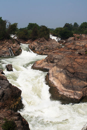 View Beauty In Nature Clear Sky Don Det Landscape Laos River Stone Sunny Day Waterfall Wildlife