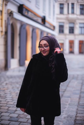 Vienna Girl Artist White Headscarf Hijab Austria City Warm Clothing Young Women Beauty Smiling Women Portrait Beautiful Woman Females Happiness Overcoat Trench Coat Old Town Winter Coat City Break Coat Sidewalk Place Of Interest Visiting TOWNSCAPE Town Square Townhouse