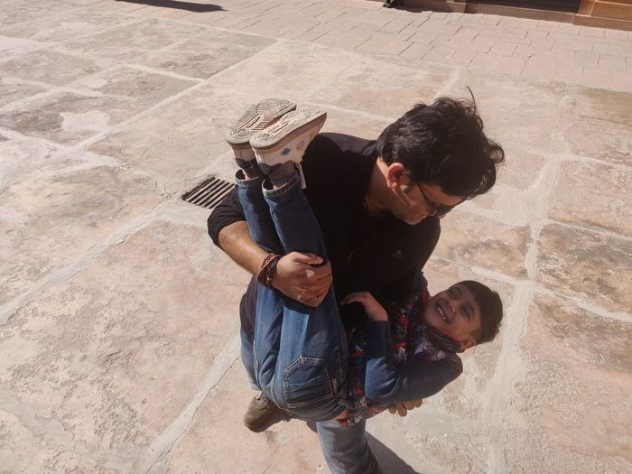 High angle view of father with daughter