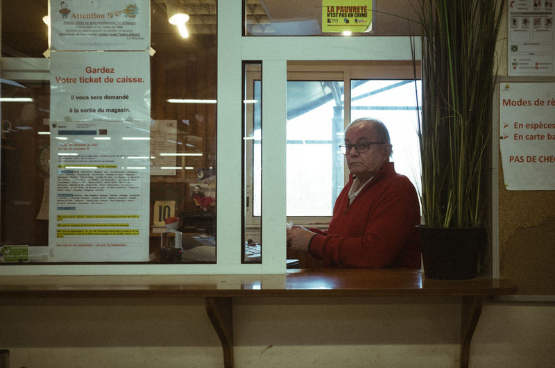 Man sitting in store