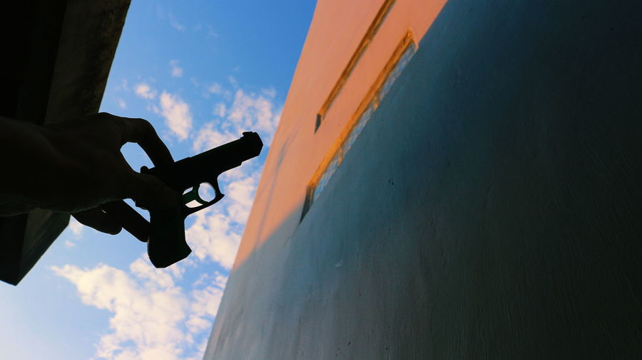 Mystery with a Gun The Week On EyeEm Sky RISK Cloud - Sky Extreme Sports Adventure Outdoors Human Hand Human Body Part People Day EyeEmNewHere Silhouette Sunlight Shadow Fine Art Photography Full Length The Still Life Photographer - 2018 EyeEm Awards