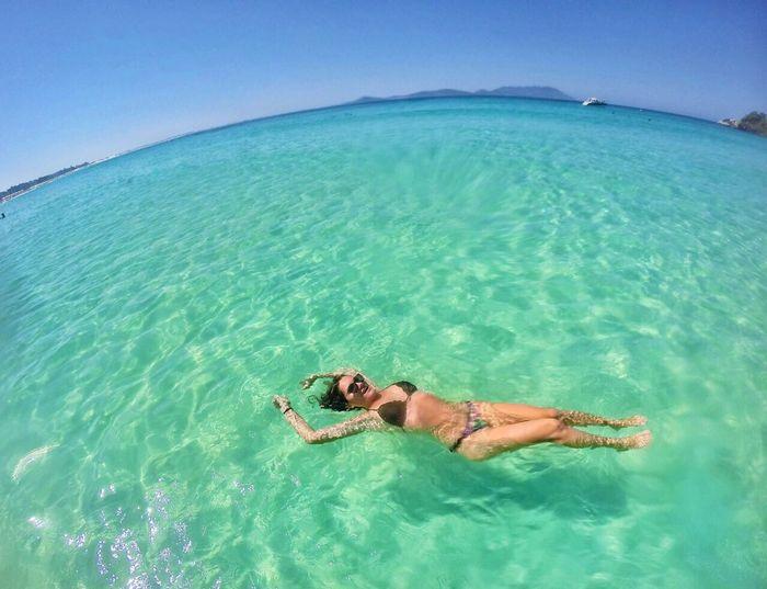 Full Length Of Woman Wearing Bikini Swimming In Sea