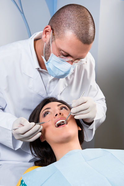 Friendly male dentist with smiling patient at dental clinic Dental Dentist Dentistry Man Medicine Office Uniform Work Attractive Caucasian Dental Clinic Friendly Healthcare And Medicine Indoors  Job Medical Occupation Orthodontic Orthodontist  Patient Procedure Professional Occupation Teeth Tooth