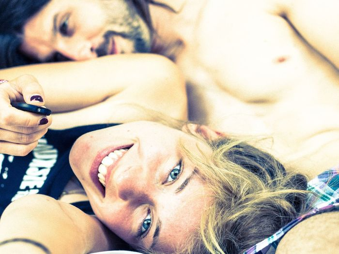 beautiful happy young woman with her boyfriend Morning Morning Rituals Togetherness Boyfriend Chilling Hanging Out In Love Looking At Camera Self Portrait Smiling Smiling Face Happy People Happiness Relationship Love Love ♥ Couple - Relationship Portrait Real People Headshot Looking At Camera Lying Down Lifestyles Leisure Activity Young Adult Relaxation Beautiful Woman Adult Moments Of Happiness