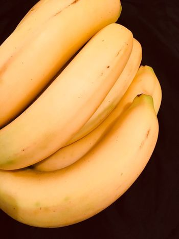 Group of bananas Bananas Food And Drink Banana Food Healthy Eating Freshness No People Black Background Close-up Studio Shot Indoors  Fruit Day