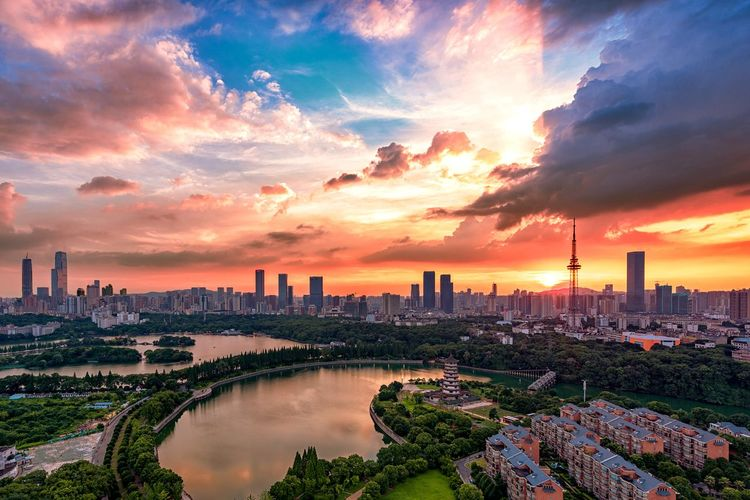 Panoramic View Of Buildings Against Cloudy Sky During Sunset