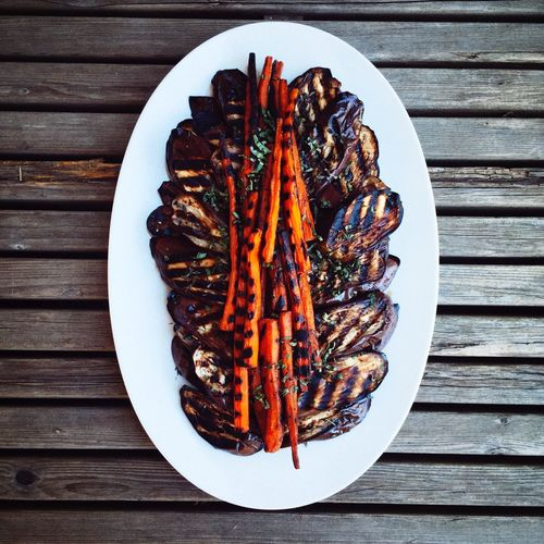 High Angle View Of Grilled Eggplant And Carrots In Plate On Table