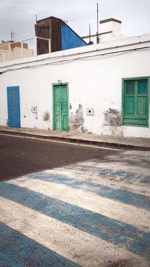 Architecture Building Exterior Built Structure Outdoors Day Street No People Road Sky Minimal Geometric Pedestriancrossing Fuerteventura Urbanminimal Streetphotography Blue