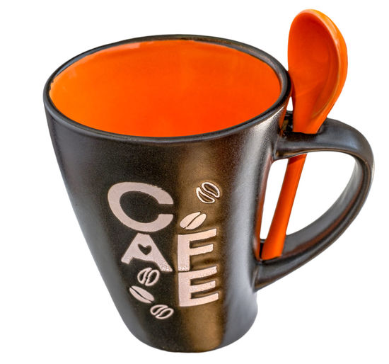 empty black ceramics mug of coffee with ceramics orange spoon Black Ceramic Coffee Spoon Black Color Ceramic Mug Ceramic Spoon Ceramic Tiles Ceramics Close-up Coffee Cup Container Crockery Cup Cut Out Drink Food And Drink High Angle View Indoors  Metal Mug Mug Cup No People Orange Color Orange Spoon Refreshment Single Object Still Life Studio Shot Text White Background