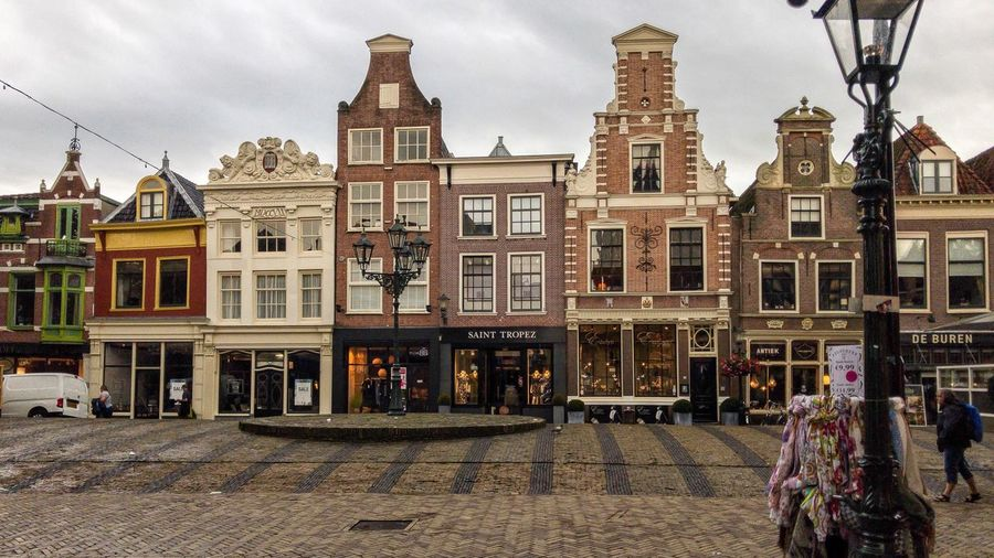 Alkmaar, Netherlands - August 15th 2017: Commercial buildings in the old town Alkmaar Netherlands North Holland Dutch Architecture Building Business Houses City Europe Façade Famous Historical House Landmark Marketplace Old Shops Square Street Tourism Traditional Unknown People Built Structure Cityscape Holiday