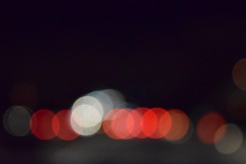 Abstract Building Exterior Circle City City Life City Street Copy Space Dark Defocused Electric Light Glowing Ideas Illuminated Lens Flare Light - Natural Phenomenon Lighting Equipment Multi Colored Night Nightlife Outdoors Sky Street Light Tail Light Traffic Vehicle Light