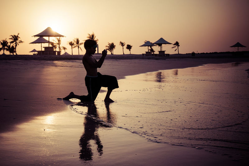 Pictures at sunset Beach Beauty In Nature Dubai Enjoyment Full Length Fun Horizon Over Water Leisure Activity Lifestyles Mamzar Beach Nature Outdoors Reflection Sand Scenics Sea Shore Sky Sun Sunlight Sunset Tranquil Scene Tranquility Vacations Water