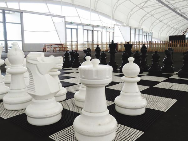 EyeEmNewHere Chess Chess Piece Chess Board Strategy Leisure Games Indoors  White Color Knight - Chess Piece King - Chess Piece Competition Checked Pattern Pawn - Chess Piece Skill  No People Queen - Chess Piece Day