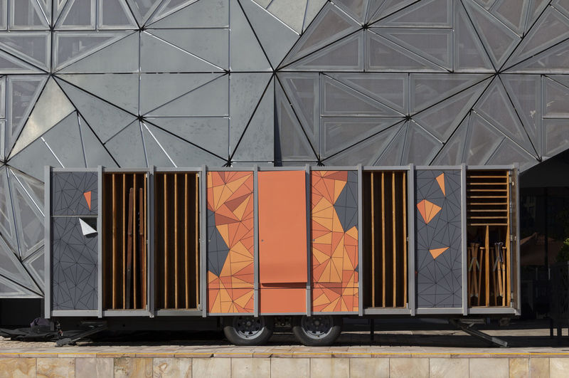 Architecture Transportation Orange Color Day Mode Of Transportation Freight Transportation Built Structure No People Outdoors Business Pattern Container Door Building Exterior Entrance Metal Rail Transportation Rear View Industry