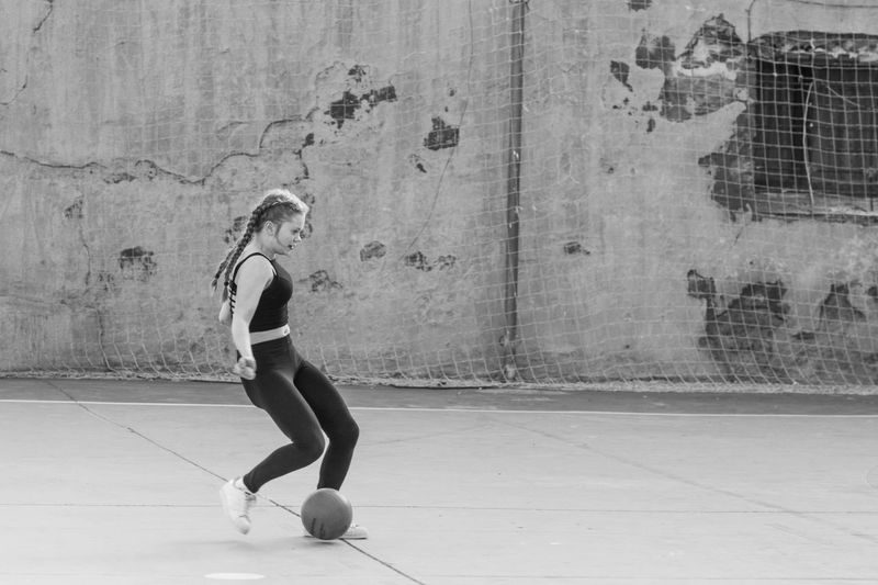 Street Football Adult Balance Ballet Dancer Day Exercising Flexibility Football Full Length Leisure Activity Lifestyles Motion One Person People Portrait Practicing Real People Skill  Sport Street Young Adult Young Women The Portraitist - 2017 EyeEm Awards